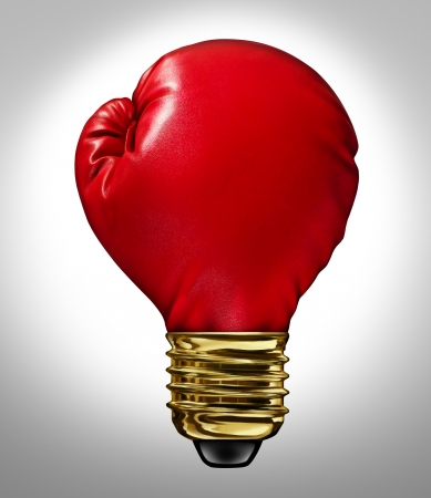 Creative power and Powerful ideas business innovation concept with a red glowing boxing glove shaped as a light bulb representing strong innovative new thinking and competitive imagination