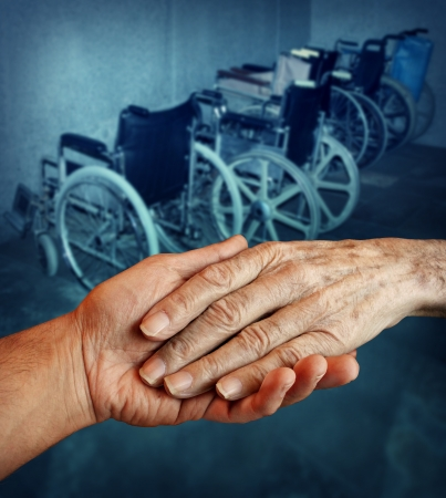 Disabled and Handicapped elderly medical health care concept with a young person holding and giving a helping hand to an old elderly grandparent with a group of wheelchairs in the background