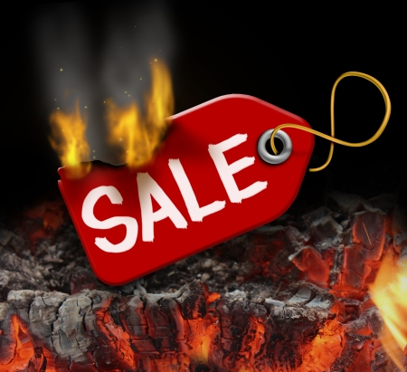 Hot sale and liquidation savings concept with a red price tag on fire over burning coals as a consumer symbol of marketing and advertising bargain prices and good value  photo