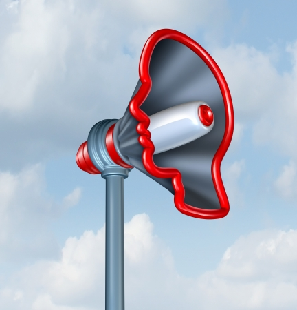 Human Communication and voicing an opinion with a megaphone or bullhorn in the shape of a human head as a concept of sending an important marketing message to connect to costumers  Archivio Fotografico