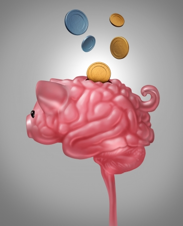 Smart saving and intelligent budget planning with a pink ceramic piggy bank shaped as a human brain with gold and silver money coins being deposited inside the three dimensional object as a financial concept  photo
