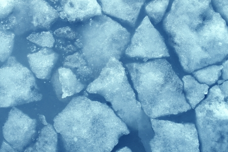 conditioned: Broken ice background as a concept of blue frigid cold temperatures as in the arctic polar climate with chunks of below zero frozen water representing cool refrigerated environment  Stock Photo