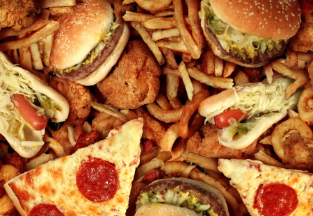 hot drink: Fast food concept with greasy fried restaurant take out as onion rings burger and hot dogs with fried chicken french fries and pizza as a symbol of diet temptation resulting in unhealthy nutrition