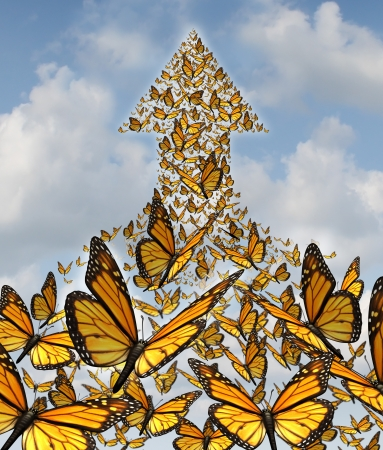 Together for success business concept with monarch butterflies flying in a large union of organized group partnership forming an arow going up to the sky as a symbol of employee solidarity and opportunity  Stock Photo