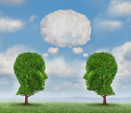 communicate: Creciendo comunicaci�n en red con un grupo de dos �rboles en forma de una cabeza humana con una palabra en blanco burbuja hecha de nubes como un concepto de negocio de crecimiento del equipo enviando un mensaje con la tecnolog�a de nube Foto de archivo