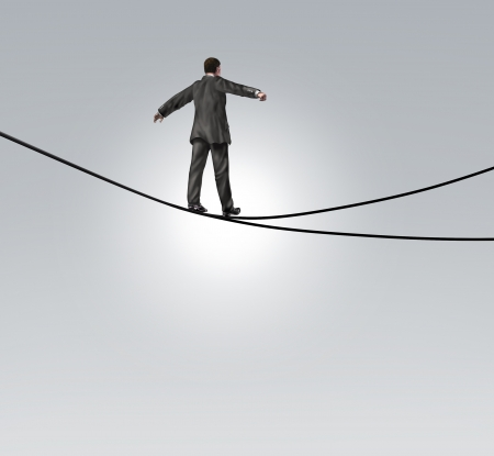 Decision risk and risky choice business concept with a businessman maintaining balance walking a high tightrope or tightwire that is split in two opposite directions as a difficult and dangerous dilemma