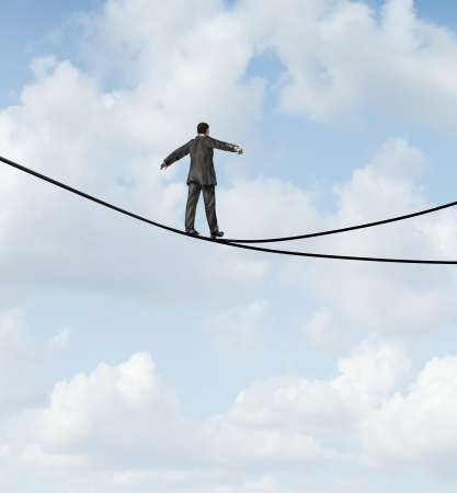 heights: Risky choice business concept with a man walking a dangerous high wire tightrope that is in a crossroads splitting into two opposite directions as a symbol of strategy dilemma deciding on the best path