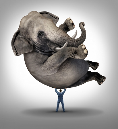 savings risk: Leadership solutions business concept with a take charge businessman lifting a huge elephant as a symbol of a strong leader with courage and determination to release the power within and achieve what is impossible
