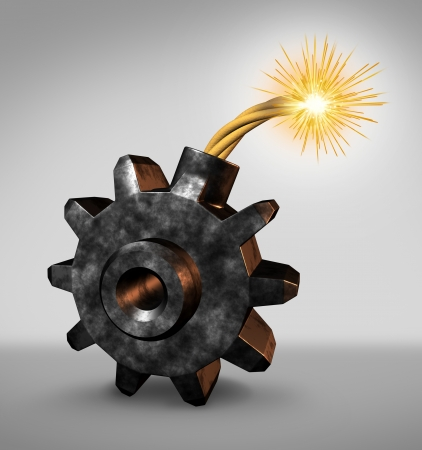 Business time bomb concept with an explosive device in the shape of a gear wheel or cog with a lit burning fuse and fire sparks feeling the financial heat as a dangerous industry warning of an urgent deadline with an impending explosion warning   photo