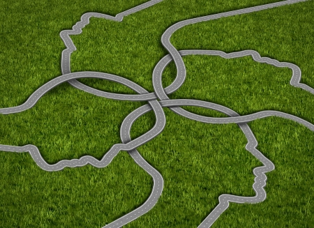 merging together: Common strategy business concept with a group of roads and highways in the shape of a human head comming together and merging into a connected network of success on a grass background