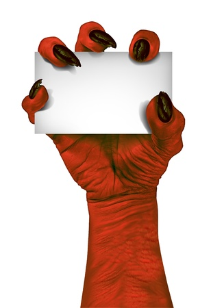 classic monster: Demon or devil hand holding a blank sign card as a creepy halloween or scary symbol with textured red skin and wrinkled monster fingers isolated on a white background