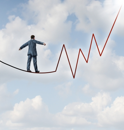conquering: Investing risk and financial management leadership skill as a business concept and metaphor conquering adverity with a businessman walking on a high wire tight rope that is in the shape of a stock market graph on a sky background