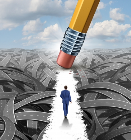 Clear the confusion leadership solutions with a businessman walking through a group of tangled roads opened up by a pencil eraser as a business concept of innovative thinking for financial success  photo