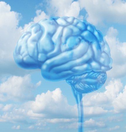 Free thinking lifestyle concept with a human brain organ floating in the sky with clouds representing fresh intelligent creative  thoughts and a healthy clean environment concept  Banco de Imagens