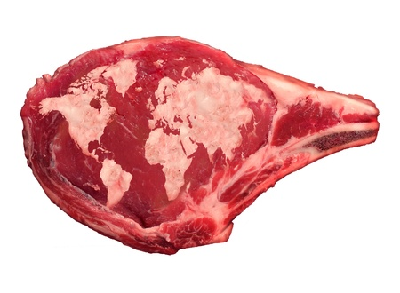 Global meat industry and world beef production food concept as a raw red rib steak with the animal fat in the shape of a map of the planet earth as an icon of international food issues