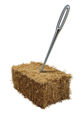 Needle in a haystack business or lifestyle concept with a giant sewing metal in a bale of hay as an icon of business guidance and easily finding what you are looking isolated on a white background  photo