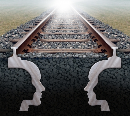 coming together: Team strategy business concept as a railroad track in perspective with the shape of two human heads underground working together as a team with a strong partnership sharing a common goal for success