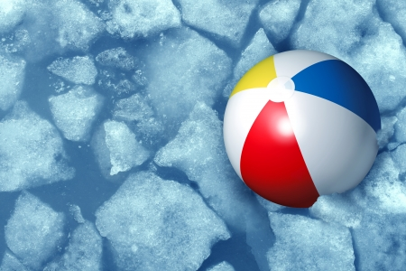 Cold summer weather concept with a plastic inflatabe beach ball stuck in frozen ice in a freezing pool as a symbol of leisure activity problems caused by colder temperatures during vacations and family holidays  Reklamní fotografie