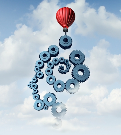 Education plan and training strategy concept with an organized group of gears and cog wheels in the shape of a human head and brain being built in the sky with a red hot air balloon as a symbol of learning with technology and the internet  Reklamní fotografie