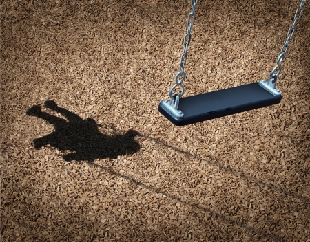 Missing child concept with an empty playground swing and the shadow of a little girl on the park floor as a symbol of children losing their childhood and being lost as in a failed adoption or youth despair caused by family violence