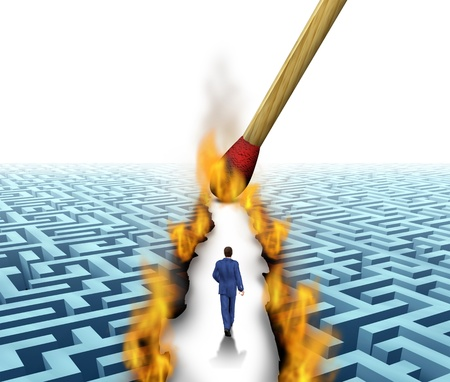Leader Solutions with a businessman walking through a complicated maze opened up by flames and fire lit by a match as a business concept of innovative thinking for financial success  photo