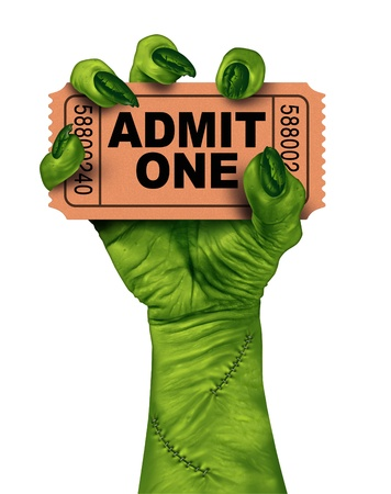 halloween background: Monster movies with a zombie hand holding a cinema or theater ticket stub as a creepy halloween or scary entertainment symbol with textured green skin and stitches isolated on a white background