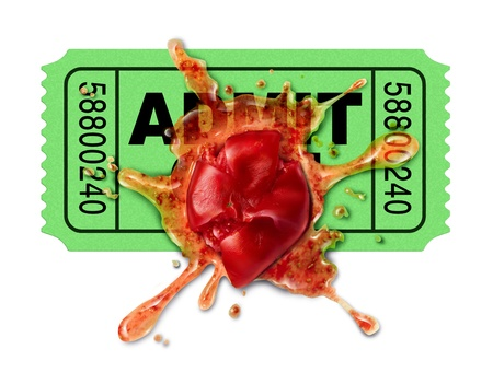 Bad movies concept with a movie ticket and a squashed tomato that has been thrown to protest an awful film flop that was disappointing to watch and as a result getting low ratings from upset film critics and viewers