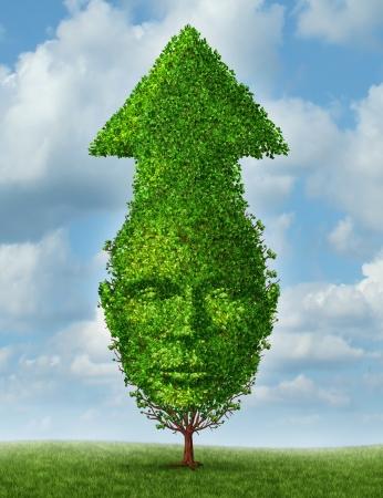 成果と人間の頭と成長と学習のシンボルとして空に上がって矢印形のツリーと成功のビジネス概念としての個人的な成長とリーダーシップ開発 写真素材