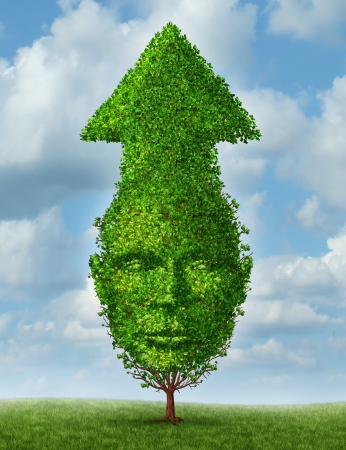 Personal growth and leadership development as a business concept of achievements and success with a tree shaped as a human head and arrow going up to the sky as a symbol of growing and learning