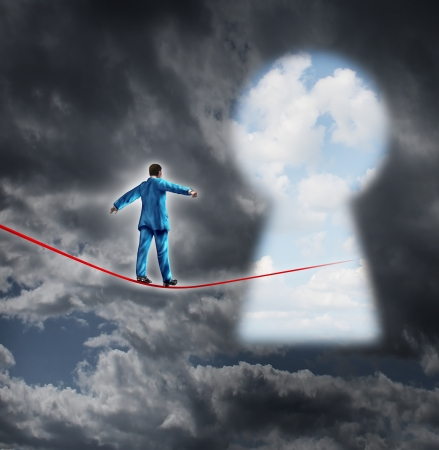Risk and opportunity business concept with a businessman on a dark storm background walking on a red tight rope that is leading into a key hole shaped as a bright sky for financial freedom and career success