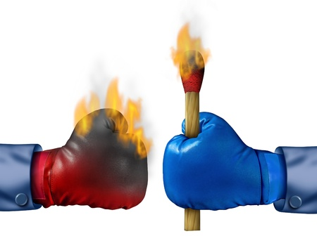 assailant: Burning the competition business concept with two competing businessmen wearing boxing gloves with one holding a lit match that has set his competitor on fire as a metaphor for strategy  Stock Photo