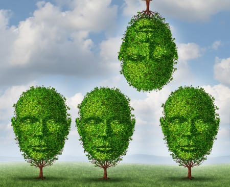 Thinking different creativity concept with a group of trees shaped as a human head with one tree upside down as a symbol freedom and of out of the box creative solutions on a summer sky background  photo