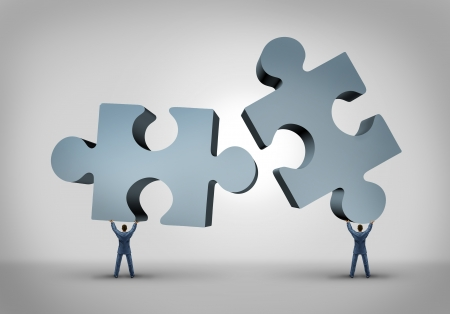 merging together: Teamwork and leadership business concept with two giant three dimensional puzzle pieces coming together from a partnership agreement between two powerful leaders who are building a successful company