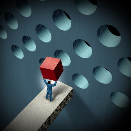 Business management challenges concept with a businessman holding a cube trying to make it fit in a round hole as a symbol of overcoming obstacles and adversity through strategy and strong leadership