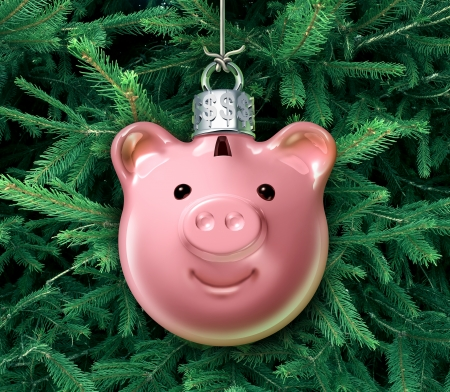 christmas bonus: Christmas business concept with a holiday tree ornament decoration shaped as a piggy bank over a green evergreen as a financial symbol of managing gift spending money during the winter festive season