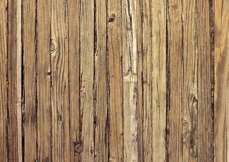 deteriorating: Old weathered wood background and natural distressed antique planks in a vertical pattern aged by the sun and water as a natural surface vintage design element