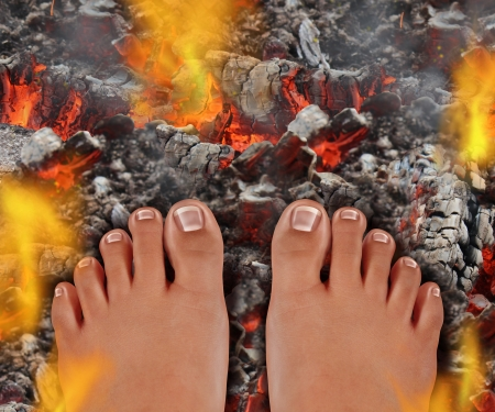 persistence: Walk on fire as a life and culture concept of the power of faith and mind over matter as a rite of passage ritual and ancient tradition walking over hot burning coals with fire flames and smoke  Stock Photo