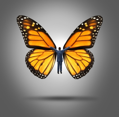 free your mind: Creative leadership concept with a businessman flying up by using the wings of a monarch butterfly as a symbol of innovation and freedom of expression to aspire to higher goals of success through confidence and belief  Stock Photo