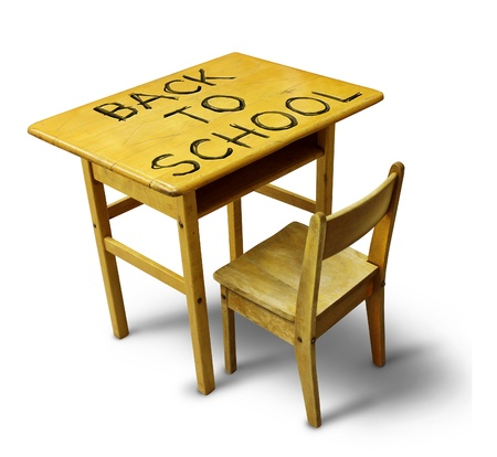 Back to school desk with a wooden education furniture equipment with the text scratched into the wood as a symbol of students returning to learning at a public institution  photo