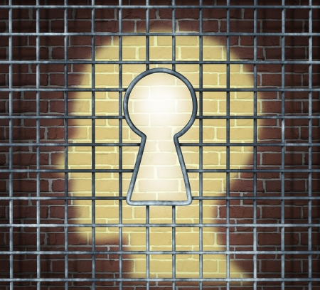 Creative freedom key with a human head light glowing on a brick wall through a prison cage opened with a keyhole shape as a business and mental health concept searching for innovative solutions to be set free for success