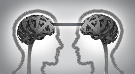 Direction communication business concept for building a bridge between two team members with symbols of human heads and brain made from tangled roads and highways connected together with a street as an icon of unity and agreement success  photo