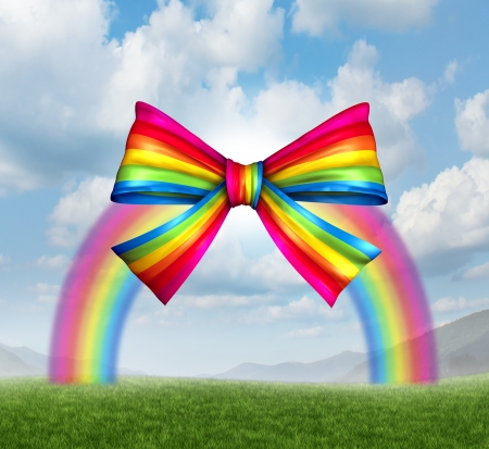 Gift of fortune and gifts from heaven concept with a colorful rainbow shaped as a fun and happy holiday ribbon and bow on a sky background as a symbol generosity in charity and donations for the joy of giving and receiving presents  Stock Photo