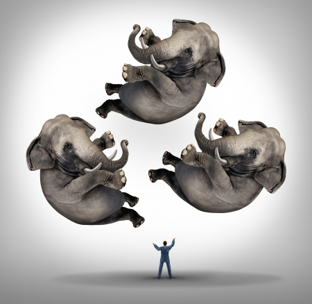 Leadership management businees concept with a businessman juggler juggling three elephants up in the air as a symbol of managing power and being a strong leader and a metaphor for expertise and skill  Stock Photo
