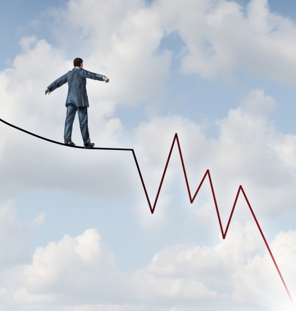 Losing Profit risk and Investment danger as a financial and business concept or metaphor facing wealth adversity as a businessman walking on a high wire tight rope shaped as a negative and downward stock market sell graph  photo