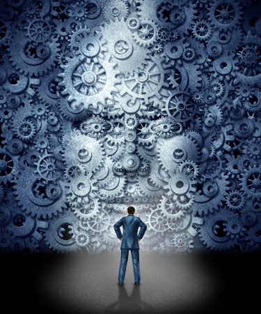 Business leadership training concept as a businessman facing a huge human head made from gears and cog wheels connected together as a symbol of industry skills education and entering a new career with the assistance of coaching and guidance  Фото со стока