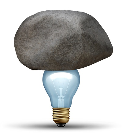 creative strength: Strong idea concept as a creative strength symbol of determination with a large rock or boulder sitting on top of a glass light bulb representing strong innovative ideas and business solutions that overcome challenges and adversity on white