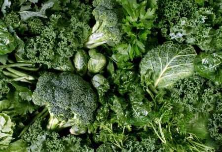 Green vegetables and dark leafy food background as a healthy eating concept of fresh garden produce organically grown as a symbol of health as kale swiss chard spinach collards broccoli and cabbage  Stock fotó