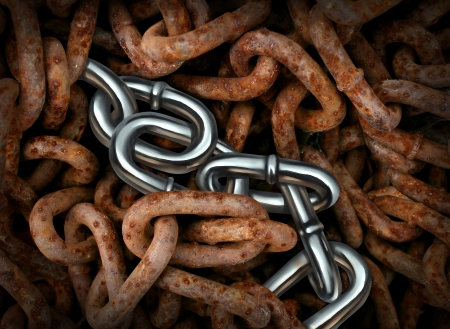 Persistence and endurance business concept with a group of old dirty rusted iron chains contrasted with shiny chrome links as a symbol of standing out from the crowd and surviving adversity and a down economy  Stock Photo - 22215821