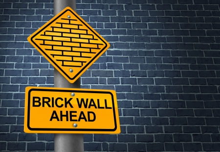restrictions: Against A Brick Wall business concept of hardship and difficult restrictions faced on a journey