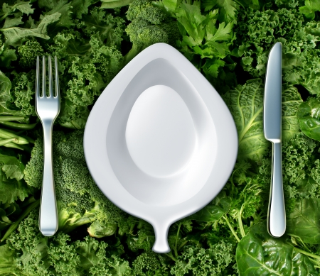 green's: Eating green vegetables and healthy diet concept with a fork knife and plate shaped as a leaf as a dinner setting on a group of dark leafy greens as a symbol of natural nutrition and a health based diet to fight cancer and live a long life  Stock Photo